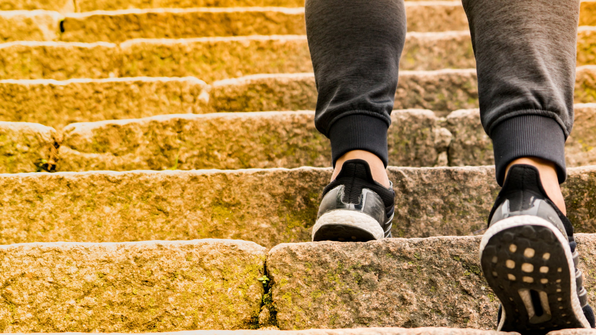 image of person walking up stone stairs